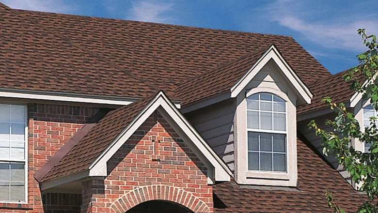 red brick with brown roof in highlands ranch