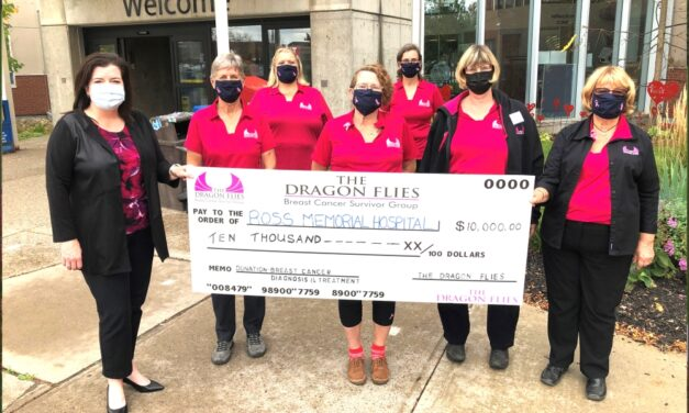 Dragon Flies present milestone gift during Breast Cancer Awareness Month