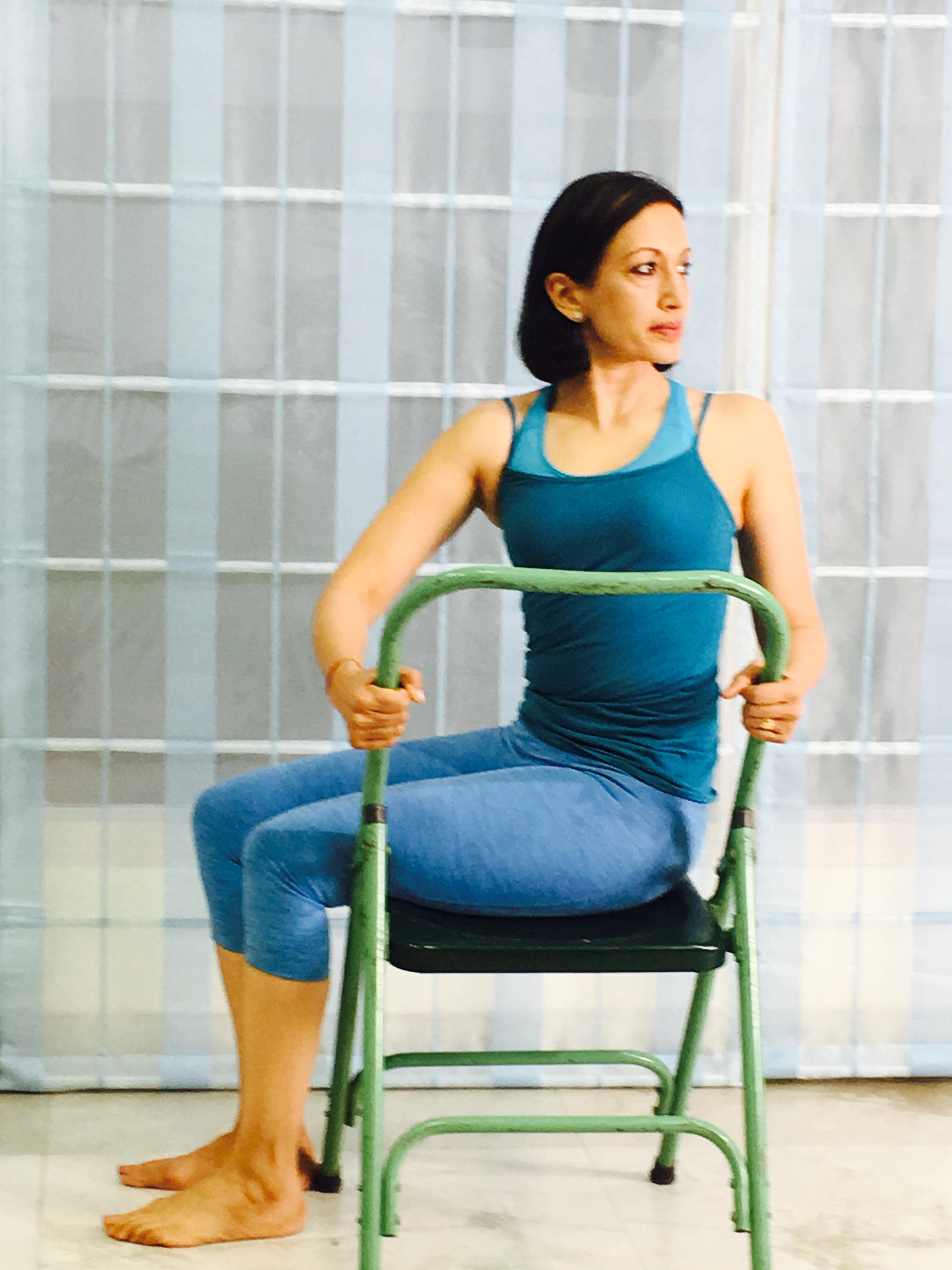 yoga chair pose torso twist