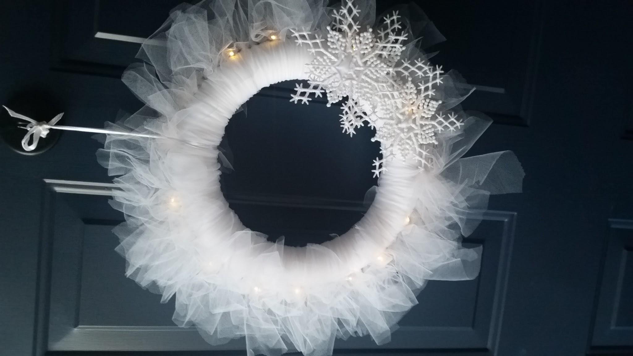 Snowflake wreath lights the winter air