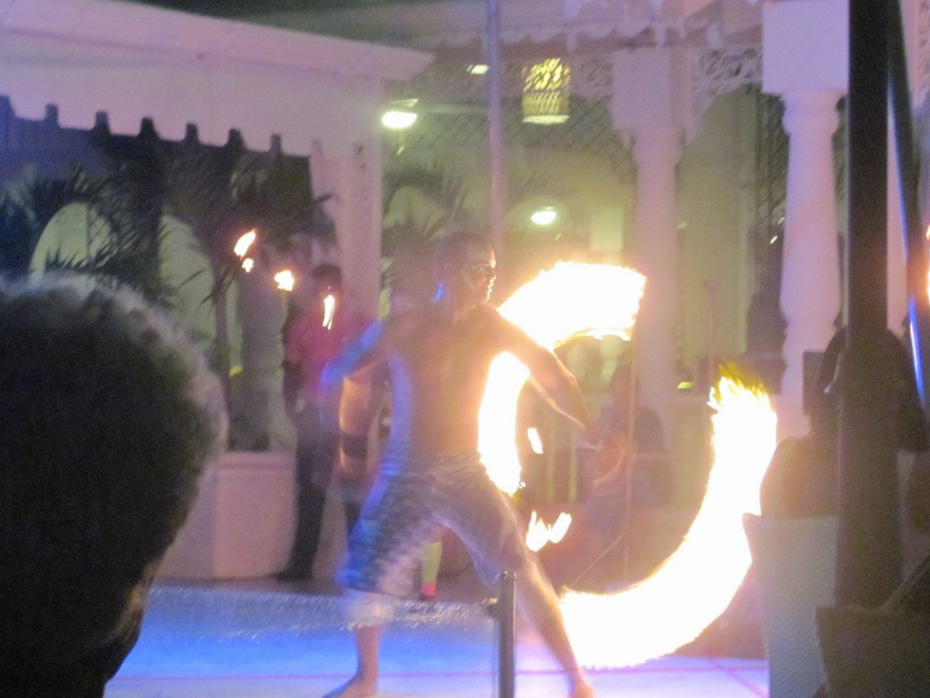 Spinning fire as part of the circus show at Bahai Principe.