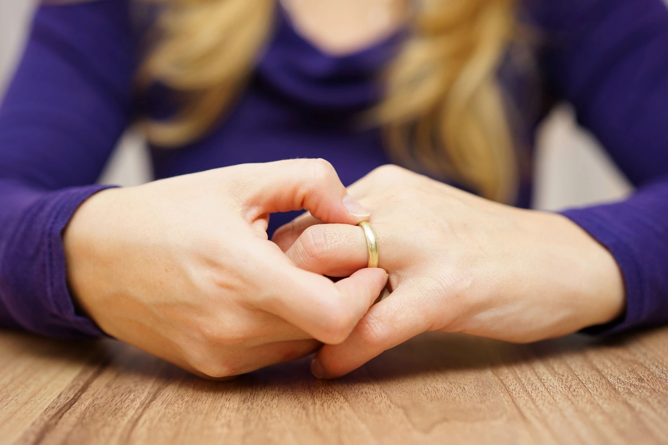 Woman ready to remove her wedding ring