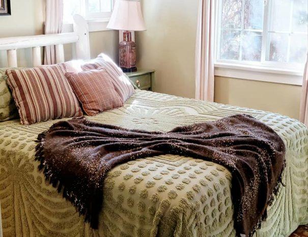 White bed with throw