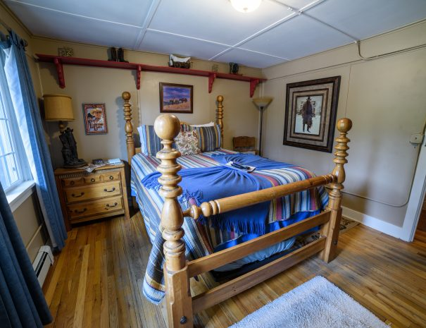 Bed with wooden posts