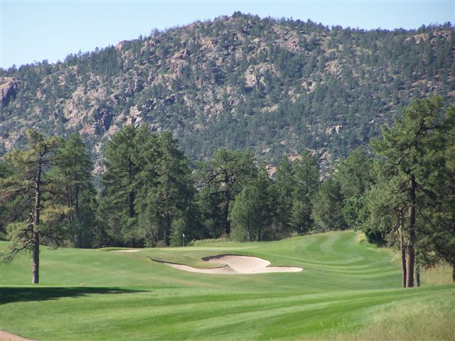 a golf course with a mountain view
