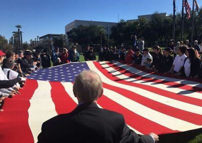 Dave Giles helping Fold USS Arizona Flag