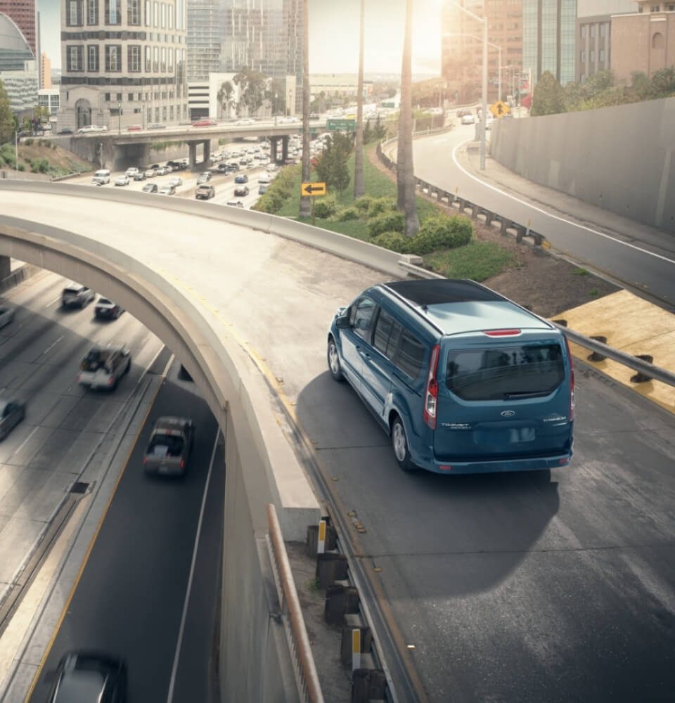Ford Transit Wagon traveling on overpass(1)