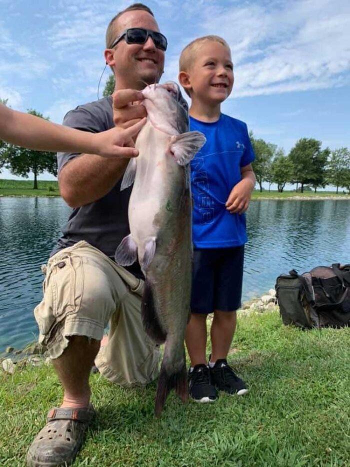 jared-burke-resized-kid-with-fish-image