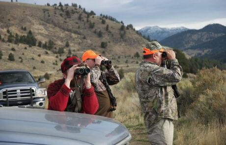 men-with-binoculars-in-mountains-photo-jared-burke-foundation