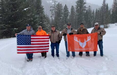 photo-of-group-holding-flag-banner-in-snow-jared-burke-foundation