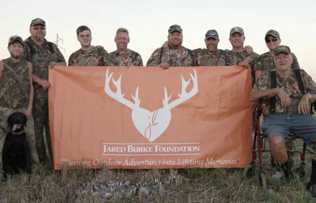 photo-of-men-with-jbf-flag-jared-burke-foundation