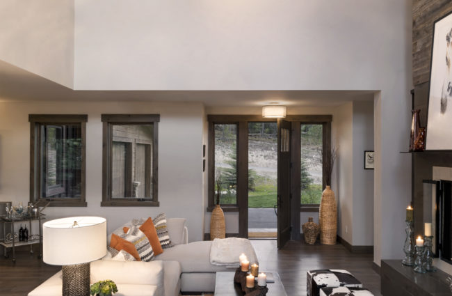 High ceilings at the living room with upper floor balcony