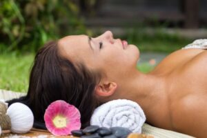 Woman lying and relaxing thinking why her skin is darker than before