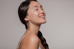 Woman smiling to show off her glowing skin