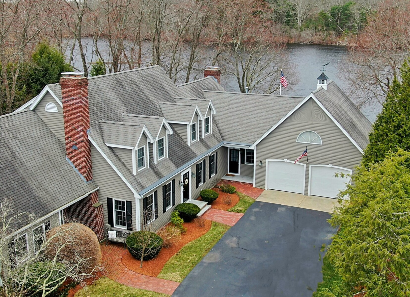 Aerial (drone) view of the front of a 2-story colonial style home in North Attleboro, MA
