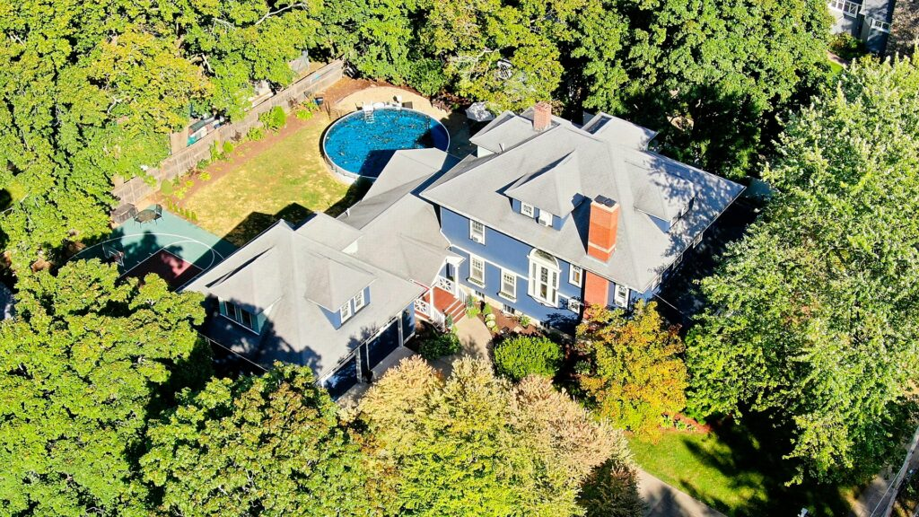 Aerial (drone) image of a 3-story colonial style home and property in North Attleborough, MA.