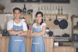 men and women in kitchen