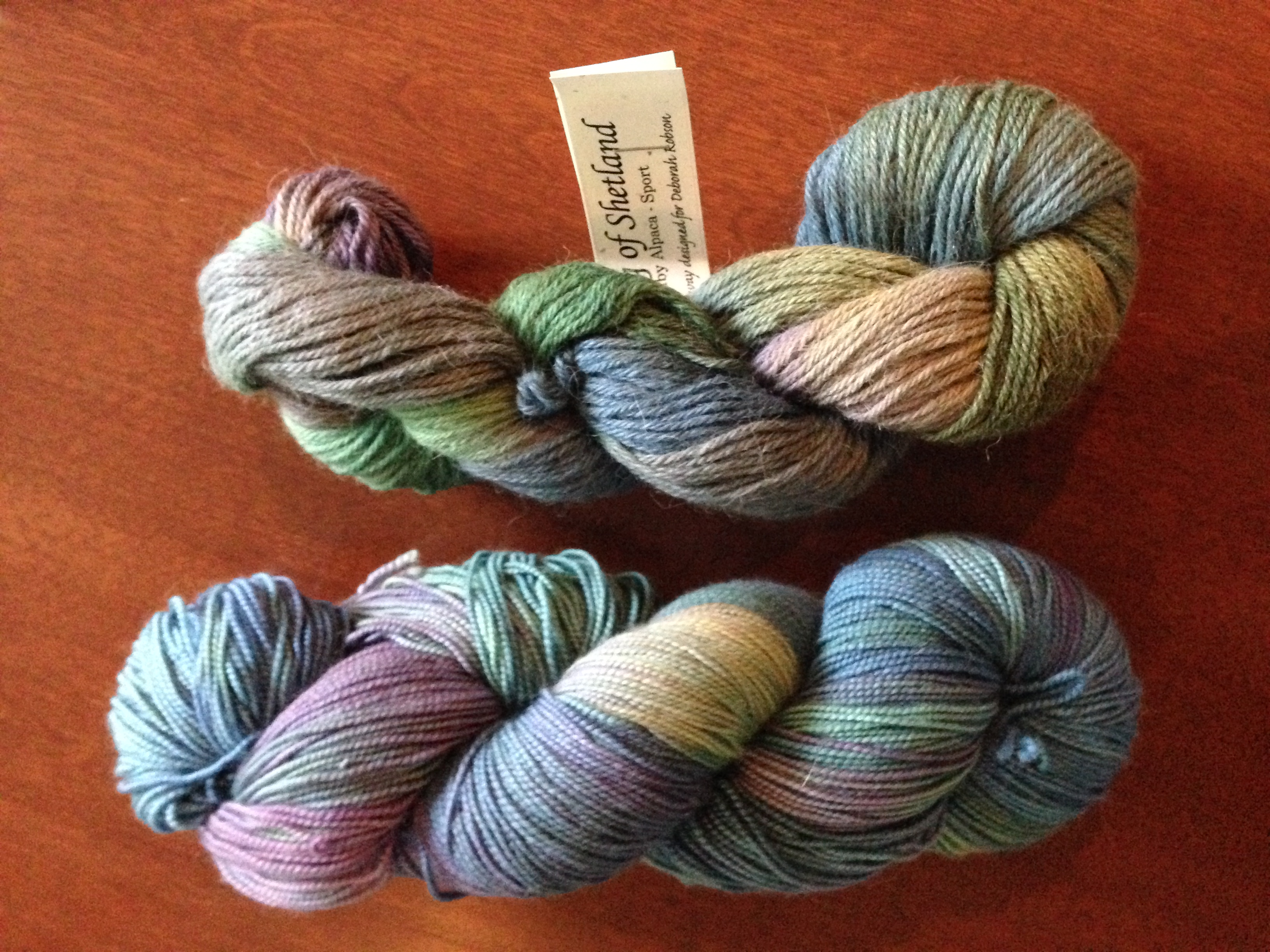 Dreaming of Shetland by Potluck yarn, on top.  Anne's skein on the bottom.  I think I am going to have a pair of socks to go with my Dreaming of Shetland shawl!