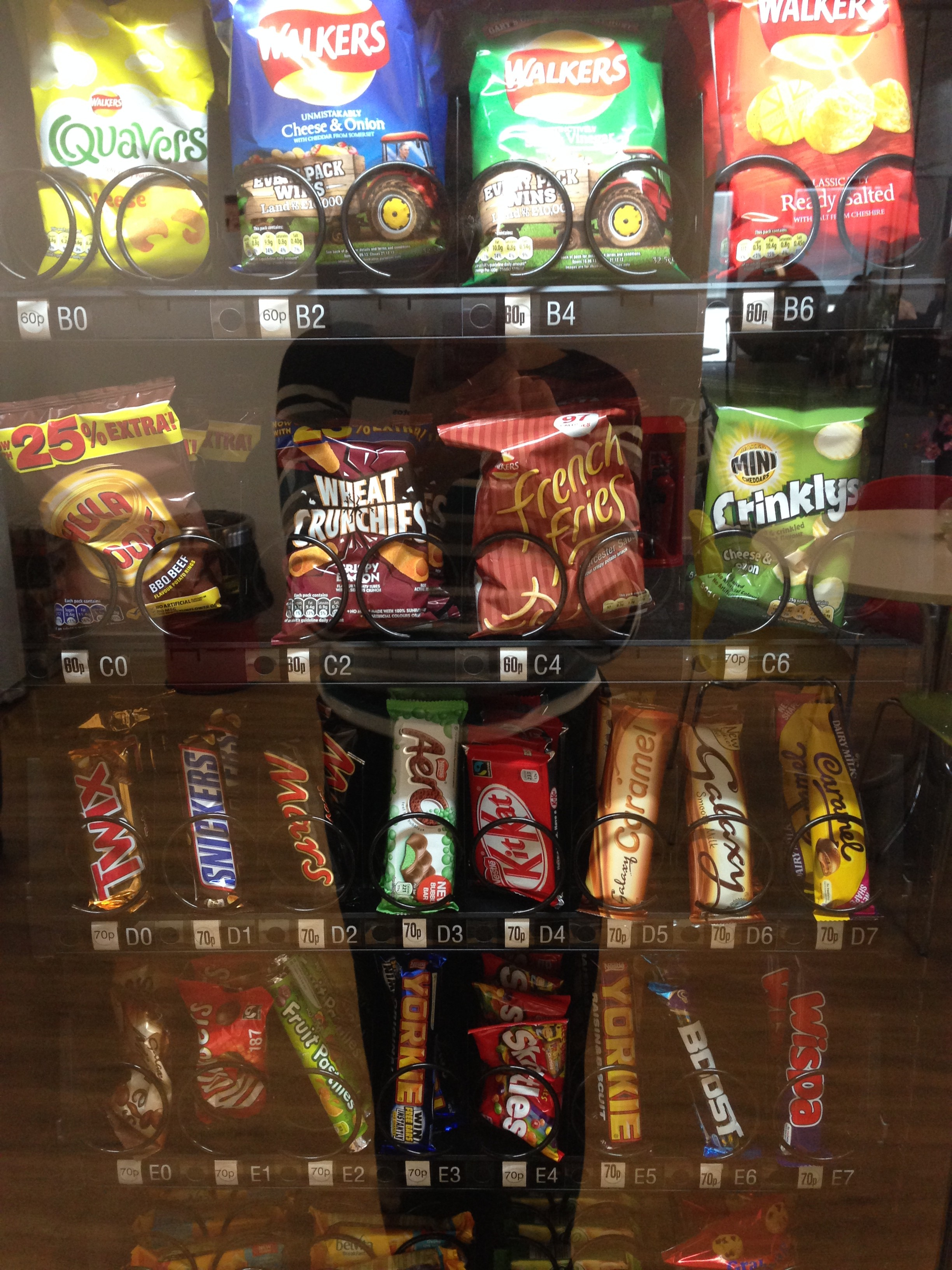 "This was the vending machine in the Optos employee lounge.  I would sort of like to try ""Crinklys"""