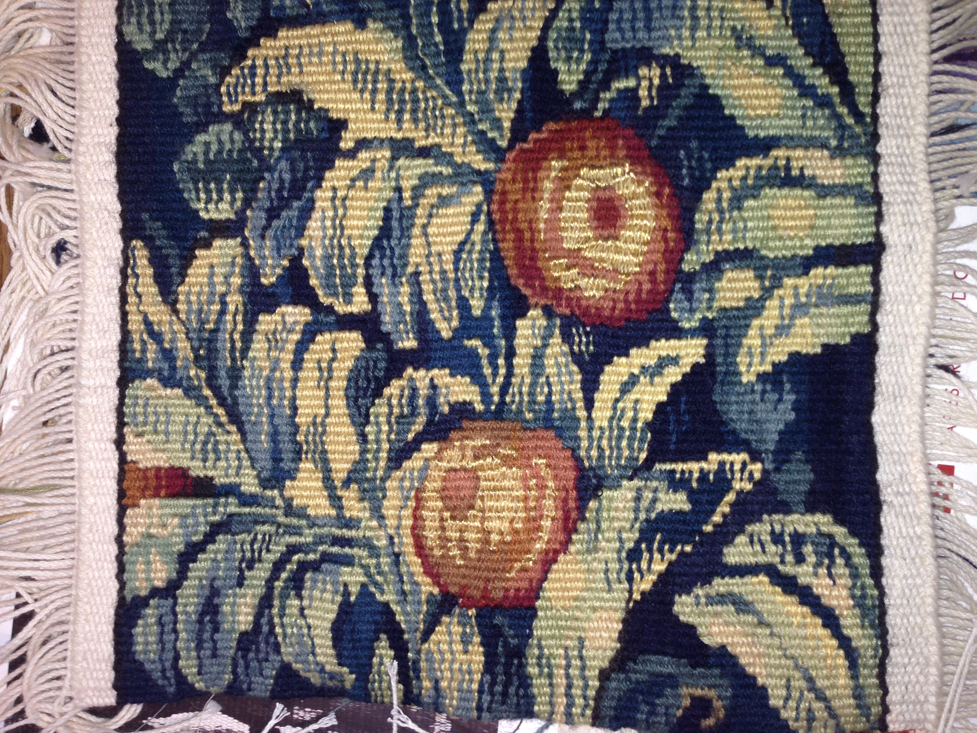 Here is the design seen from the right side of the work.  This is not part of a Unicorn tapestry, but a sample woven by a weaver doing a modern scene.  West Dean College is doing astounding work in this field, and the samples were inspirational.