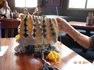 Same trip, same socks, but at lunch.  Annetarsia is the most portable knitting project you can imagine, even with 2 socks on the needle!