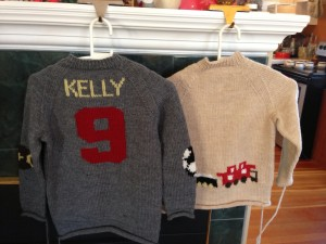 The Kelly sweaters seen from the back