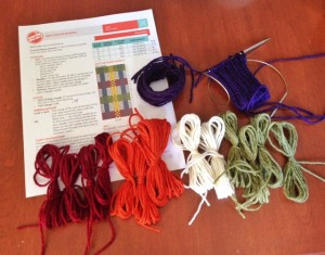 """Yarn supplies, from left to right, are A, B, C and D, with the MC small sections wound above them  The cuff is knit, with the MC, on a 24"""" circular needle, using Magic Loop method.  I'm ready to knit Row 1 of the chart!"""