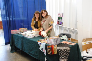 Marcia took this photo of me and my table partner, Wendy Johnson, setting up the table at Rhinebeck.