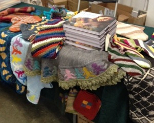 """Setting up the author's table at Rhinebeck.  Within hours, every book Merritt Bookstore had ordered was sold, and the table wasn't organized anymore!  But knitter's loved checking out the projects from """"Annetarsia Knits"""""""