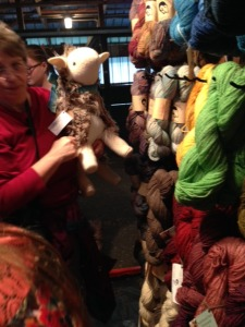 """Marcia Weinert and her new sheep, """"MacDugal"""", trying to make their way through a crowded booth."""
