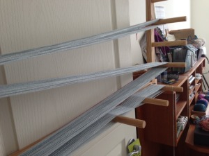 """Winding the strands onto a warping board.  At the bottom, see where the yarn is """"crossing"""".  This keeps the strands separated."""