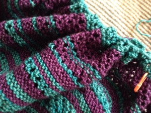 """I was too lazy to switch needles, so the stitches are all crammed onto the same 24"""" needle that I started with.  There are supposed to be 387 sts, but I added a bunch of rows so I know there are many more.  They are too crowded to count, and I don't want to know, anyway.  I'm just hoping the needle doesn't break.  It wouldn't be pretty."""