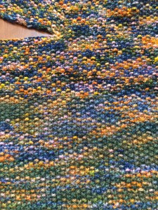You can see where I changed skeins, as the colors shift.  This happens with hand-dyed yarns, and I embrace the effect on this project, as I think it adds to the feeling of a varied skyline.  The greener skein feels more like ground, and the bluer more like sky.  I am loving this!