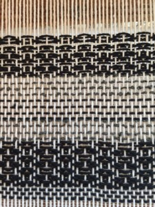 The black cotton is Sugar and cream, the gray is scrap boucle.  Pattern is Rosepath, and I threw some Plain weave stripes in there, too.