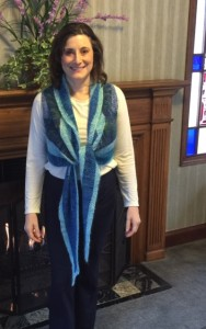 """Worn tied in the front, with the thin blue edge at the top (the shawl can be worn """"upside down"""")"""