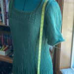 unblocked sweater body, 3 inches longer than the pattern calls for, to allow for expected shrinkage.