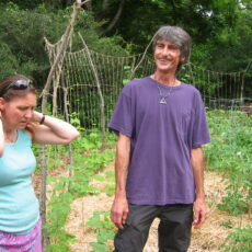 Debby Ward and Russell Furbush show a gorup of students a garden project