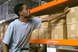 warehouse worker stocking shelves