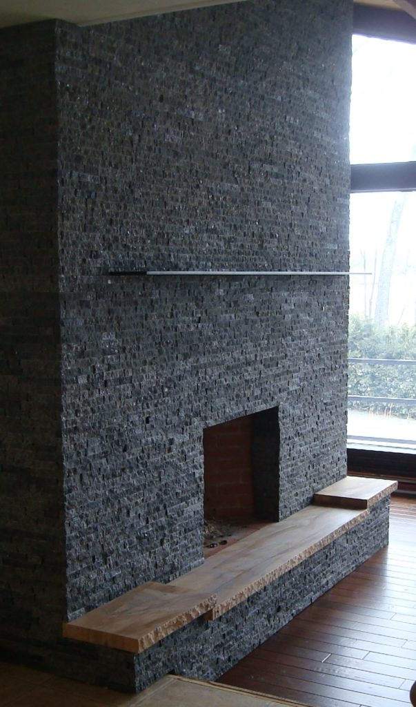Restored fireplace with granite face