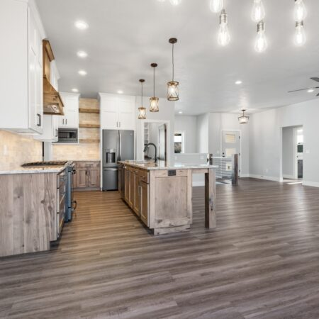 Open concept kitchen and dining space in new home built by Virtue Homes custom home builders.