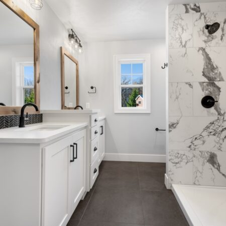 Stunning white and marble bathroom in new home by Virtue Homes custom home builders.