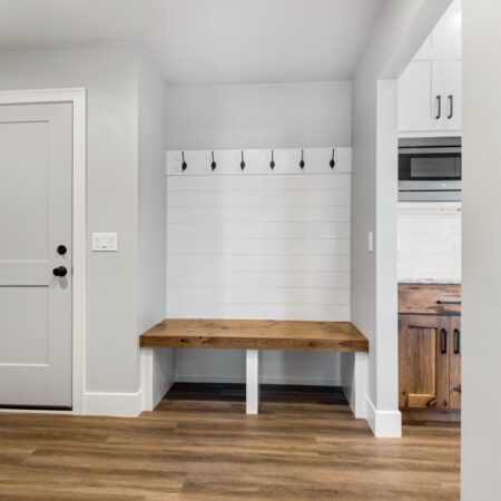 White and wood mudroom in new home by Virtue Homes custom home builders.