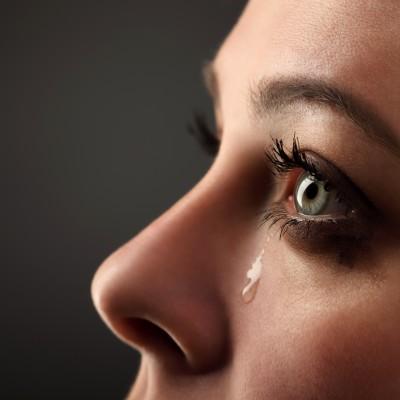 woman crying - process of forgiveness