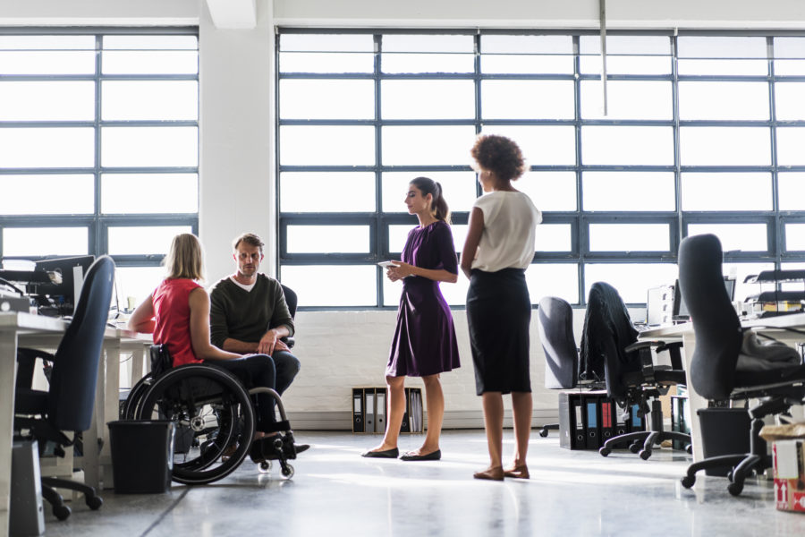 Disability inclusion in the workplace with people in wheelchairs.