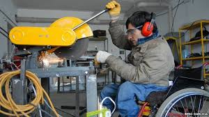 Disability, equality, & inclusion: A factory worker in a wheel chair