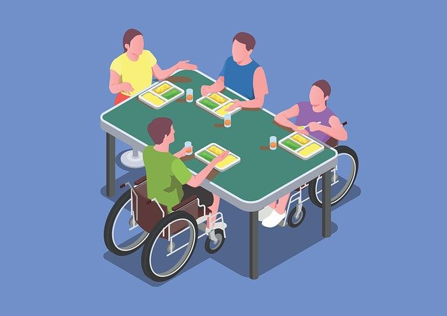 Disability integration graphic with people in wheelchairs sitting alongside others around a table.