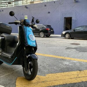 This an image of an electric scooter parked illegally on the street.
