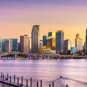 Miami, Florida, USA skyline on Bisayne Bay at dusk.