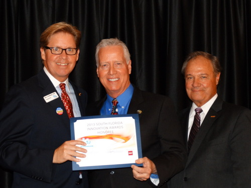 Dan Lindblade, Chamber President and CEO, Logan Pierson, President, SmartWater CSI and Chuck Mohr, Chamber Chair and Regional Retail Banking Manager for BB&T.