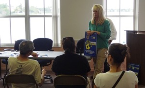 SmartWater CSI Community Relations Director Brenda Bailey talks with Coral Bay residents.